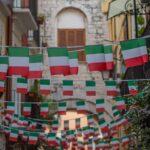dozens_of_italian_flags_waving_above_bari_street